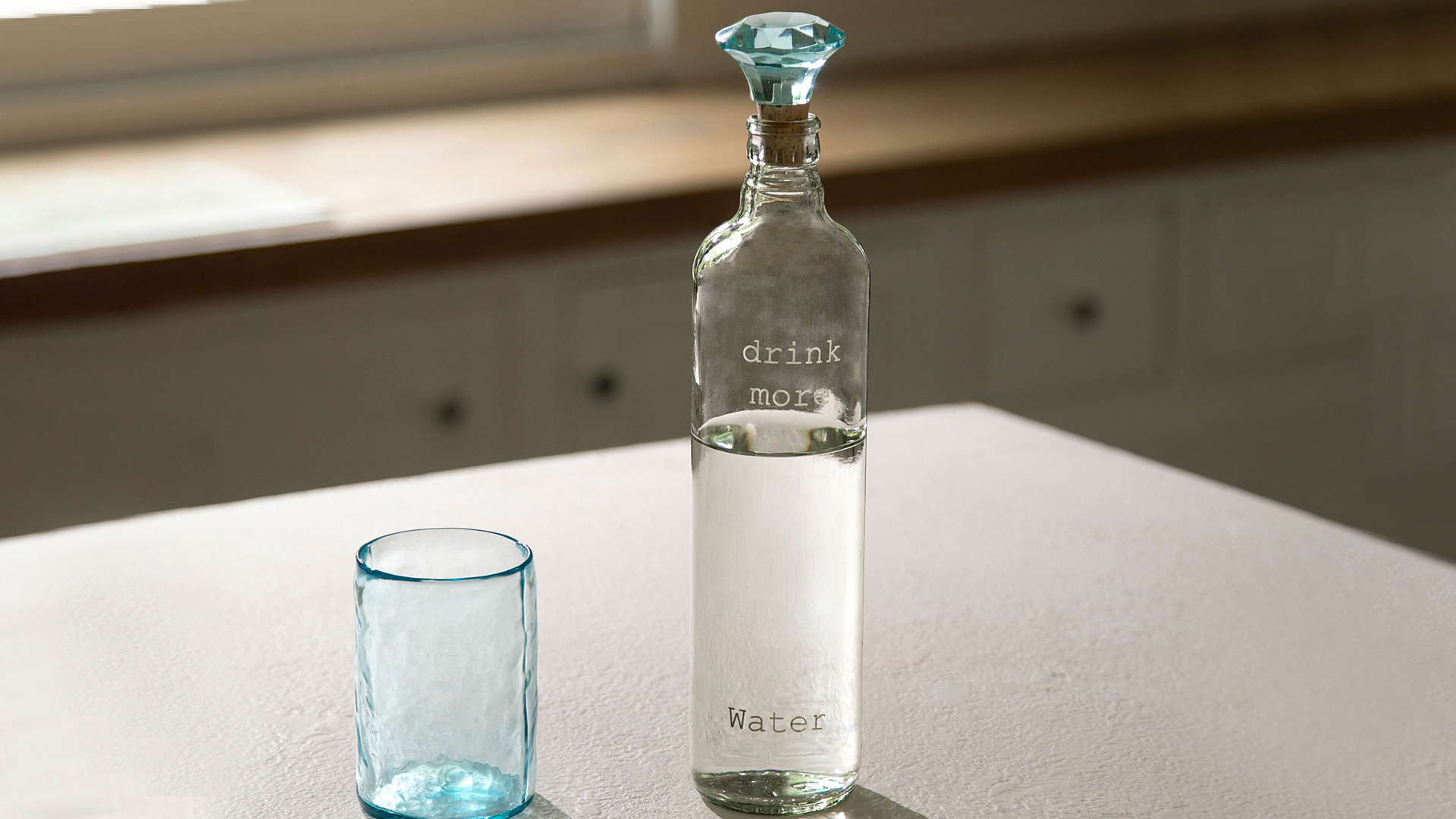 glass bottle with tumbler